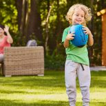 boy holding rugby ball