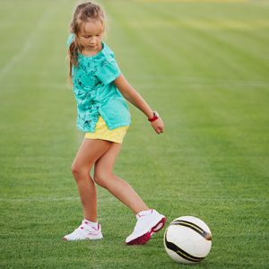 girl showing off football skills