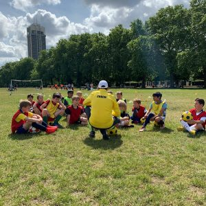 coaching football to kids